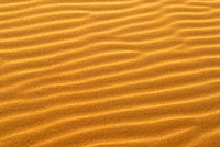 Pattern of golden sand on sand dune