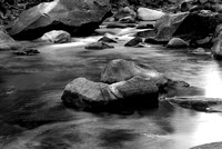 Black and white image of small rapids in Merced River in Califor
